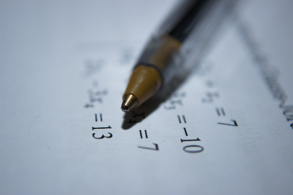 Pen on Paper over Math Problem